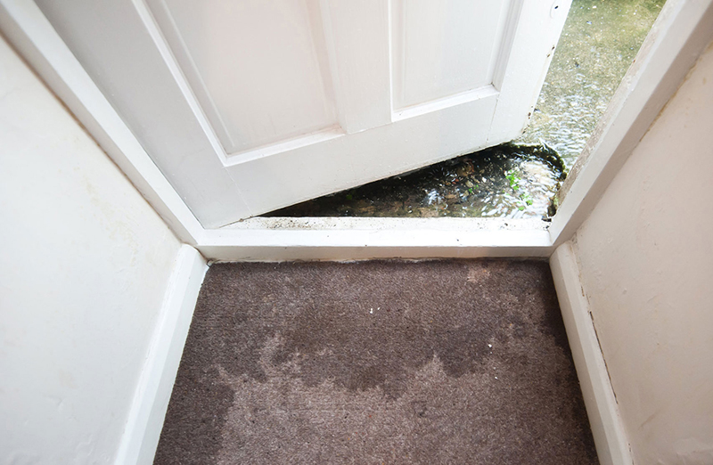 a flood outside of a home door